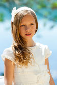 Attractive youngster in white communion dress. — Stock Photo