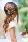 Detail of girl's communion hairstyle. — Stock Photo