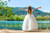 Small princess in white dress at lake. — Stock Photo