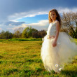 Young girl wearing white dress in late afternoon sun. — Stock Photo