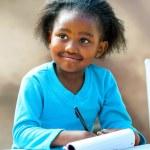 Afro student doing schoolwork. — Stock Photo #48678623