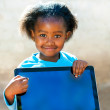 African kid pointing at blank digital screen. — Stock Photo