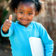 Cute african girl with notebook. — Stock fotografie