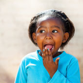 African girl with hand on open mouth. — Stock Photo