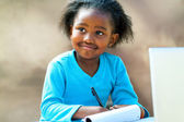 Afro student doing schoolwork. — Stock Photo