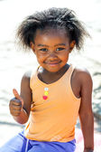 African youngster doing thumbs up sign. — Stock Photo