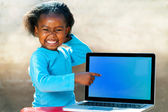 Funny african girl pointing at blank screen. — Stock Photo