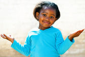 Wondering african girl with arms open. — Stock Photo