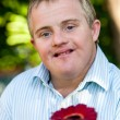 Handicapped boy giving flower. — Stock Photo #49368217