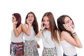 Group of teen girls talking on smart phones — Stock Photo