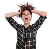 Shouting Teen girl with hands in hair — Stock Photo