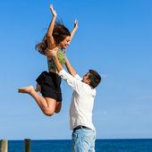 Girl jumping into boys arms — Stock Photo