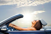 Young girl driving convertible — Stock Photo