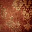 Stock Photo: Floral pattern on fabric texture