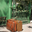 Two retro suitcases near the door waiting for departure — Stockfoto