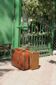 Two retro suitcases near the door waiting for departure — Stock Photo
