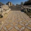 Stock Photo: Ancient stone mosaic at destroied basilica in antique greece cit