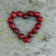 Summer love concept sweet cherry heart on weathered rustic woode — Stock Photo