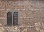 Windows with grilles of old buildings — Stock Photo