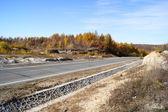 Autumn road through hills — Стоковое фото