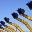 Excavator buckets against the blue sky — Stock Photo