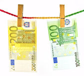 Euro money hanging with wooden clothes pin — Foto de Stock