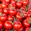 Fresh tomatoes on street market - Stock Photo