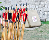 Archery arrows with target background — Stock Photo