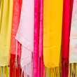 Colorful scarves hanging - Stock Photo