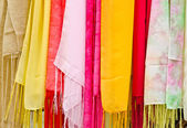 Colorful scarves hanging — Stock Photo