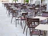 Cafe terrace with tables and chairs — Stockfoto