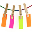 Wooden clothes pin and colorful blank paper on rope — Stock Photo
