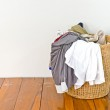Clothes in a laundry basket — Stock Photo