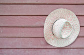 Old hat on a wooden wall — Stock Photo