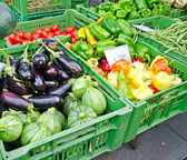 Fruits and vegetables at market stall — Stock Photo