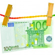 Euro money hanging with wooden clothes pin — Stock Photo #39486843