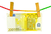 Euro money hanging with wooden clothes pin — Stock Photo