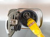 Close up of fuel nozzle. Fill up fuel at gas station. — Stock Photo