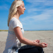 Young woman meditating from side — Stock Photo