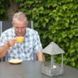 Retired senior Dutch man drinking coffee — Stock Photo