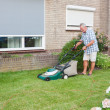 Dutch senior mowing lawn — Stok fotoğraf
