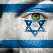 Flag painted on face with green eye to show Israel support — Stock Photo