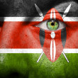 Flag painted on face with green eye to show Kenya support - Stock Photo