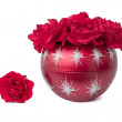 Christmas ornament filled with red roses — Stock Photo