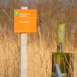 Warning post Entrance to a bird nesting reserve — Stock Photo