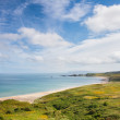 The sunny coast and beach of White Park Bay — Stock Photo