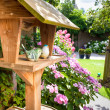 Bird house in backyard - Stock Photo