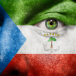 Flag painted on face with green eye to show Equatorial Guinea su - Stock Photo