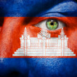 Flag painted on face with green eye to show  Cambodja support — Stock Photo