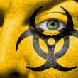 Royalty-Free Stock Photo: Biohazard symbol painted on face